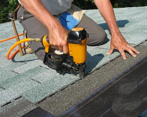 roofer laying shingles